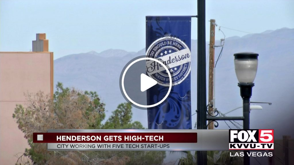 Henderson Gets High Tech News Caption with City Background